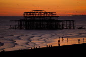 Sunset over the derelict West Pier, Brighton - Jess Hurd - 2010s,2015,beach,beaches,beauty,CLIMATE,COAST,coastal,coasts,conditions,derelict,DERELICTION,evening,holiday,holiday maker,holiday makers,holidaymaker,holidaymakers,holidays,Leisure,LFL,LIFE,OCEAN,PEO