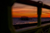 Sunset over the derelict West Pier, Brighton - Jess Hurd - 2010s,2015,beach,beaches,beauty,CLIMATE,COAST,coastal,coasts,conditions,derelict,DERELICTION,evening,OCEAN,Pier,sea,seafront,SEAFRONTS,seashore,seaside,seasides,SHORE,shores,SUN,sunset,sunsets,WATER,W