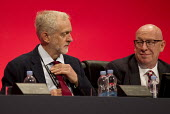 Jeremy Corbyn adjusting his tie Labour Party Conference Brighton. - Jess Hurd - 30-09-2015