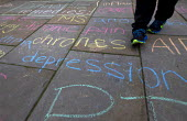 Cannabis medicinal remedies written in chalk by campaigners on the pavement outside Parliament. Westminster. London. - Jess Hurd - 13-10-2015