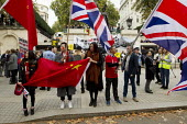 Pro China nationalists try to obscure Free Tibet human rights protest at state visit of Chinese president Xi Jinping London - Jess Hurd - 2010s,2015,activist,activists,against,anti,BAME,BAMEs,BME,bmes,CAMPAIGN,campaigner,campaigners,CAMPAIGNING,CAMPAIGNS,china,chinese,DEMONSTRATING,Demonstration,DEMONSTRATIONS,diversity,ethnic,ethnicity
