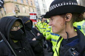 Policewoman and Anarchists TUC march against austerity cuts and unfair Trade Union Bill, Conservative Party Conference, Manchester. - Jess Hurd - 04-10-2015