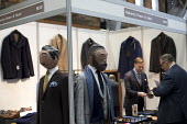 Tailors, Doherty, Evans and Stott stand. Conservative Party Conference, Manchester. - Jess Hurd - 2010s,2015,apparel,buy,buyer,buyers,buying,capitalism,capitalist,clothes,clothing,commodities,commodity,conference,conferences,CONSERVATIVE,Conservative Party,conservatives,EBF,Economic,Economy,garmen