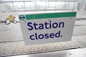 Station closed sign. Docklands Light Railway RMT strike against understaffing and bullying of members working for Amey Docklands. Poplar DLR Station. East London. - Jess Hurd - , Trades Union,2010s,2015,against,closed,closing,closure,closures,disputes,INDUSTRIAL DISPUTE,member,member members,members,people,RAIL,railway,RAILWAYS,RMT,sign signs,station,Station Platform,STATION