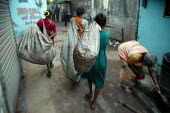 Women collecting plastic bags for recycling Mumbai India - Jess Hurd - 18-01-2004