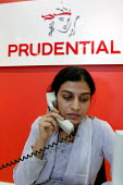 Worker talking on the telephone. Prudential call centre Mumbai India - Jess Hurd - 19-01-2004