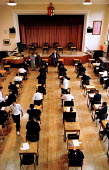 School pupils sit an examination at Bishop Vesey Grammar School, Sutton Coldfield, West Midlands. NEAB General Certificate of Secondary Education GCSE. - Jess Hurd - 23-06-1999