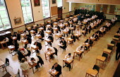 Teachers oversee school pupils sitting an examination at Bishop Vesey Grammar School, Sutton Coldfield, West Midlands. NEAB General Certificate of Secondary Education GCSE. - Jess Hurd - 23-06-1999