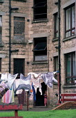 Child and washing drying. Tenement housing on estate in Possil. Council flats boarded up but most still occupied. Glasgow housing stock due to transferred to housing company - Jess Hurd - 18-09-1999