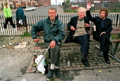 Drinkers sitting together on a park bench. Housing estate in Possil. Glasgow - Jess Hurd - 18-09-1999