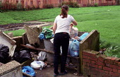 Putting out the rubbish. Tenement housing on estate in Possil. Council flats. Glasgow housing stock due to transferred to housing company - Jess Hurd - 18-09-1999