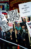 'Safety before profits' on our Railways protest march called by families groups, RMT & ASLEF trades unions. London - Jess Hurd - 06-11-1999