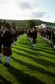 Pipe Band, Cowal Highland Gathering, Dunoon, Scotland. - James Jenkins - 2000s,2002,ACE arts culture,ANNUAL,BAGPIPE,BAGPIPES,Band,bands,CUSTOM,CUSTOMS,Festival,FESTIVALS,GAMES,HIGHLAND,KILT,KILTS,melody,music,MUSICAL,musical instrument,musical instruments,musician,MUSICIAN