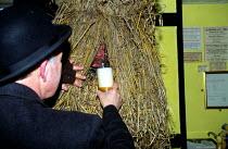 Whittlesey Straw Bear Man drinking beer. Cambridgeshire - James Jenkins - 11-01-2003