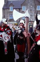 Guizer Jarl Squad Horn Blower, Up Helly Aa, Lerwick, Shetland Islands - James Jenkins - 2000s,2003,Aa,ACE,ACE culture,annual,axe,axes,costumes,culture,customs,festival,festivals,Helly,helmet,helmets,heritage,island,Islands,Lerwick,Nordic,Norse,PEOPLE,scotland,scottish,season,Shetland,She