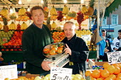 Frank Maloney, UK boxing promoter and UK Independence Party canditate for 2004 London Mayoral election, meeting Lewisham Market traders who have been prosecuted for not changing their weighing scales... - James Jenkins - 15-11-2003