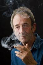 Man smoking a cigarette. - Paul Carter - 04-09-2007