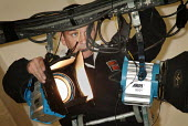 Lighting engineer adjusting the stage lights. - Paul Carter - 21-10-2003