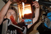 Lighting engineer adjusting the stage lights. - Paul Carter - 21-10-2003