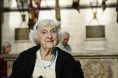 Portrait of an elderly woman in a wheelchair, during a visit to Salisbury Cathedral. - Paul Carter - &,2000s,2008,90's,adult,adults,age,aged,ageing population,belief,bound,Cathedral,CATHEDRALS,christian,christianity,christians,church,churches,conviction,culture,disabilities,DISABILITY,disable,disable