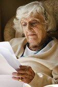 Portrait of an elderly woman sitting in a chair, reading. - Paul Carter - 15-09-2008