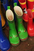 Brightly coloured wellington boots outside a nursery school. - Paul Carter - 2000s,2004,activities,amphibian,amphibians,animal,animals,apparel,blue,boots,CARE,carer,carers,child,CHILD CARE,childcare,CHILD-CARE,CHILDHOOD,CHILDMINDING,children,childs,child's,CLIMATE,clothing,col