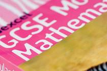 GCSE Maths textbook, in a Maths lesson at a secondary school. - Paul Carter - 10-07-2007