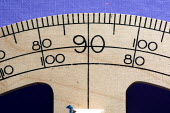A wooden protractor, in a Maths lesson at a secondary school. - Paul Carter - 2000s,2007,angles,arithmetic,calculate,calculations,circular,degrees,edu,EDU education,educate,educating,education,educational,equipment,geometry,knowledge,learn,learner,learners,learning,mathematics,
