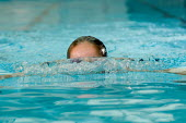 A pupil swimming breaststroke in a P.E. lesson at a secondary school. - Paul Carter - 10-07-2007