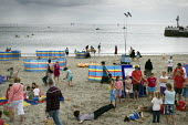 Looe beach with children's activities happening on an overcast day with the sea in the background, Looe, Cornwall, UK - Paul Carter - 04-08-2010
