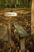Private woodland. A wooden stile with a dog gate separating public and private land. - Paul Carter - 30-10-2010