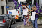 Social workers (members of Unison) of Southampton Social Services picket. They are on strike for a week to protest about newly enforced contracts giving them less pay and poorer conditions. Passing mo... - Paul Carter - 05-08-2011