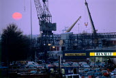 Looking over a car showroom, to cranes on the docks. Sunset, Southampton - Paul Carter - 12-12-1998