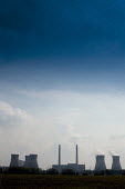 Blue sky over a ploughed field and chimneys of a electricity generating station. - Paul Carter - 1990s,1996,capitalism,capitalist,chemical,CHEMICALS,chimney,chimneys,CLOUD,clouds,coal,cooling,EBF economy,ELECTRICAL,electricity,emissions,energy,engineering,ENI environmental issues,environmental de
