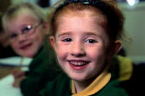 A young school girl smiling. - Paul Carter - 20-10-1999