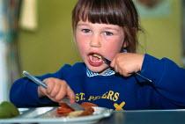Young schoolgirl eating her dinner. - Paul Carter - 05-07-1997