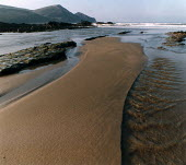 Small river flows across a sandy beach into the sea. - Paul Carter - 01-08-1990