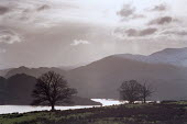 Ullswater, with surrounding hills covered by snow and mist. - Paul Carter - 25-12-2000