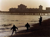 Children playing on the beach at sunset with South Parade Pier in the background. - Paul Carter - 11-04-1996