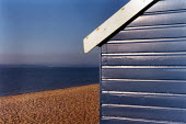 Looking past a brightly painted beach hut, to a stoney beach, sea and The Isle of Wight. - Paul Carter - 31-05-1994