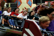 Girls ride on a fast fairground ride. - Paul Carter - ,1980s,1989,ACE entertainment,adolescence,adolescent,adolescents,attraction,EMOTION,EMOTIONAL,EMOTIONS,ENJOYING,enjoyment,fair,fairground,fairgrounds,female,females,fun,funfair,funfairs,funny,girl,Gir