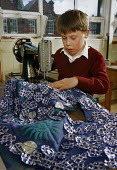 Boy making a costume using a sewing machine. - Paul Carter - 01-12-1986
