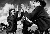 Friends playing clapping games in a school playground. - Paul Carter - 1980s,1989,boy,BOYS,break,break time,child,CHILDHOOD,children,DINNER,dinners,DINNERTIME,EDU Education,EMOTION,EMOTIONAL,EMOTIONS,female,females,Friends,funny,game,games,girl,girls,HAPPINESS,happy,Humo