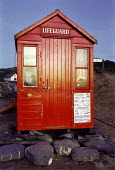 Bright red lifeguard hut on the beach. Crackington Haven, North Cornwall. - Paul Carter - 01-08-1992
