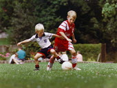 Two young boys playing football in a park. - Paul Carter - 01-08-1993