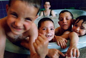 Young children in a jacuzzi in a swimming pool. - Paul Carter - 05-06-1992