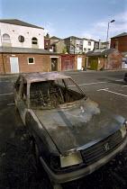 Burnt out car in an inner city car park. - Paul Carter - 05-06-2001