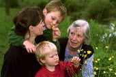 Family enjoying wild flowers along the banks of the River Itchen. - Paul Carter - 21-05-2000