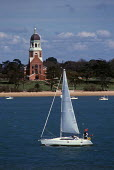 Yacht sailing past the Chapel (now a museum) in Royal Victoria Country Park. - Paul Carter - 15-04-1989