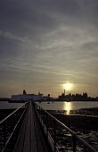 Looking along a jetty to Southampton silhouetted skyline and a docked car ferry. Taken at sunset. - Paul Carter - 29-04-1995